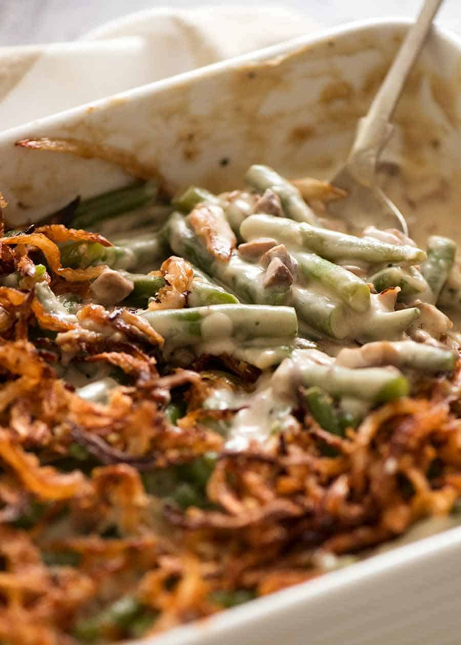 Close up of Green Bean Casserole in a white casserole dish, ready to be served