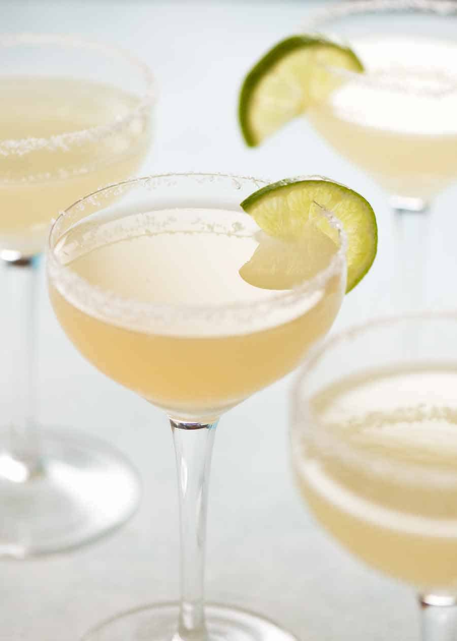 Margaritas with lime wedges, ready to be served